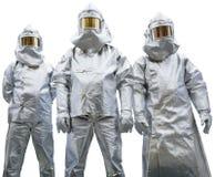 Drie arbeiders in beschermende kleding Stock Foto's