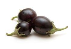 Drie aubergines Stock Fotografie
