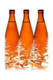 Drie bierflessen in een rij Stock Foto's