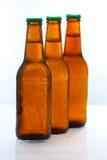 Drie bierflessen op de hoogte Stock Afbeeldingen