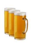 Drie biermokken Stock Afbeeldingen