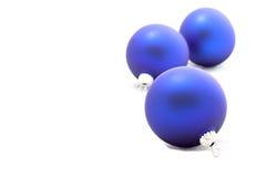Drie blauwe Kerstmisballen Stock Afbeelding