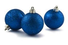 Drie blauwe snuisterijen van Kerstmis Stock Afbeelding