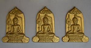 Drie Boedha op Grijze muurachtergrond Stock Fotografie