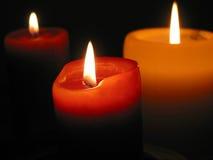 Drie brandende kaarsen Stock Afbeeldingen