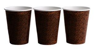 Drie Bruine koffiekoppen met een boonaf:drukken Royalty-vrije Stock Foto's