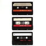 Drie cassettes die op wit worden geïsoleerd Royalty-vrije Stock Fotografie