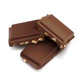 Drie chocoladerepen die bovenop elkaar op liggen Royalty-vrije Stock Afbeeldingen