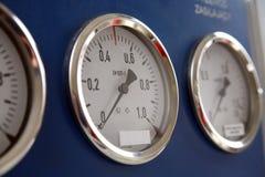 Drie controlemeter Stock Foto