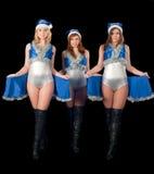 Drie dansende Kerstmisvrouwen Stock Afbeeldingen