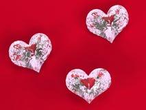 Drie diamanten op rood Stock Afbeelding