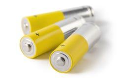 Drie die batterijen, op witte achtergrond worden geïsoleerd Royalty-vrije Stock Foto