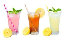 Drie die glazen de zomerdranken met stro op wit wordt geïsoleerd Royalty-vrije Stock Fotografie