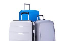Drie die koffers op witte achtergrond worden geïsoleerd Stock Afbeelding
