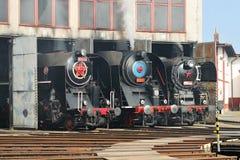 Drie die oude locomotief stomen Stock Fotografie