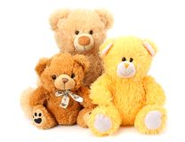 Drie die stuk speelgoed teddyberen op witte achtergrond worden geïsoleerd stock foto's