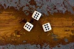 Drie dobbelen met nummer zes Stock Fotografie