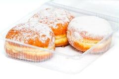 Drie donuts in een plastic doos Royalty-vrije Stock Foto