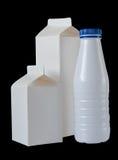 Drie Dozen van de Melk per halve liter op zwarte Royalty-vrije Stock Foto's