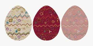Drie eieren met een vrolijk abstract patroon Stock Fotografie