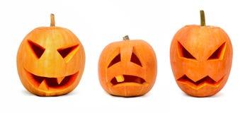 Drie emotionele Halloween pompoenen Stock Foto