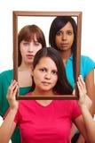 Drie ernstige vrouwen in een frame Stock Fotografie