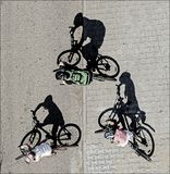 Drie fietsers stock afbeeldingen