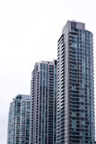 Drie flatgebouwen Stock Afbeelding