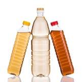 Drie flessen azijn Royalty-vrije Stock Afbeeldingen