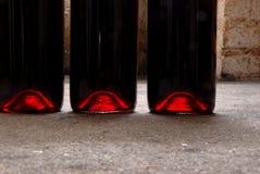 Drie flessen rode wijn royalty-vrije stock afbeelding
