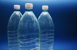 Drie flessen zuiver water Stock Afbeelding