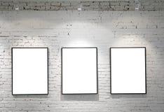 Drie frames op bakstenen muur Royalty-vrije Stock Foto's