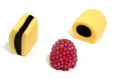 Drie fruitsnoepjes in de vorm van kloppers van diverse kleur 3 Stock Foto