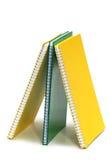Drie geïsoleerder bindmiddelenboeken Royalty-vrije Stock Afbeeldingen