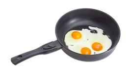 Drie gebraden eieren op de pan tijdens het koken Royalty-vrije Stock Foto