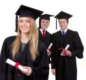 Drie gediplomeerden Stock Foto