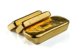 Drie gegoten goudstaven, de typische vorm van passement gouden passement royalty-vrije stock afbeeldingen