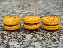 Drie gele macarons Stock Foto