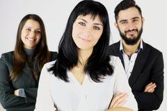 Drie gelukkige glimlachende bedrijfsmensen stock foto's