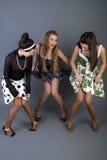 Drie gelukkige retro-gestileerde meisjes Stock Foto's