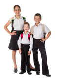 Drie gelukkige studenten die zich verenigen Stock Foto's
