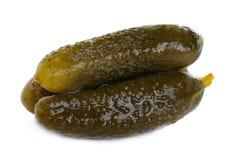 Drie gemarineerde ingelegde komkommers Stock Afbeelding