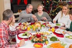 Drie generatiefamilie die Kerstmisdiner hebben samen Royalty-vrije Stock Foto