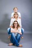 Drie generaties met een opvallende gelijkenis stock afbeeldingen