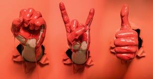 Drie geschilderde handen met verschillende gebaren stock foto's