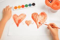 Drie geschilderde harten, concept familie Royalty-vrije Stock Foto