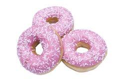 Drie geïsoleerder doughnuts Stock Afbeeldingen