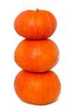 Drie gestapelde pompoenen Stock Fotografie