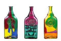 Drie glasflessen met een abstract patroon Royalty-vrije Stock Foto's
