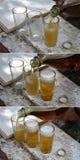 Drie glazen bier wordt gegoten Stock Afbeeldingen